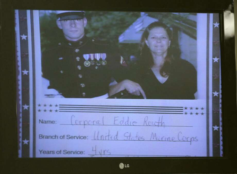 A photo of Jodi Routh and her son, former Marine Cpl. Eddie Ray Routh, is shown on a screen after it was admitted into evidence during Eddie Ray Routh's murder trial Thursday. Photo: LM Otero, POOL / AP