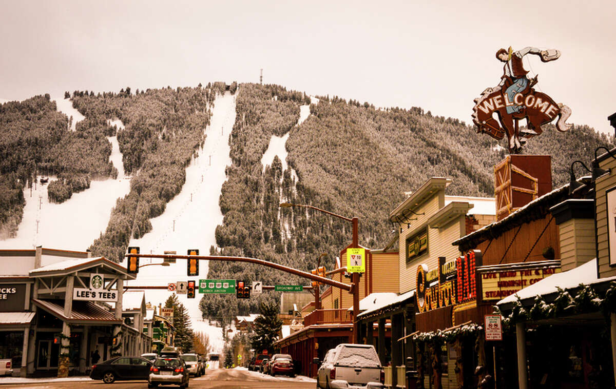 The slopes that rise up Snow King Mountain loom over downtown Jackson, Wyo.
