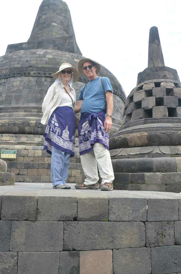 Jay Bray and Maureen Dunn on top of the Buddhist temple at Borobudur in Jogjakarta. / ONLINE_YES