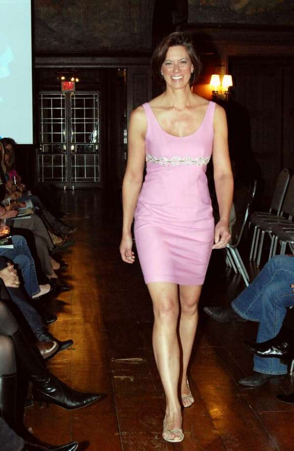 Babette DeFellce poses in pink on the Waveny House runway. Photo: Jeanna Petersen Shepard / New Canaan News