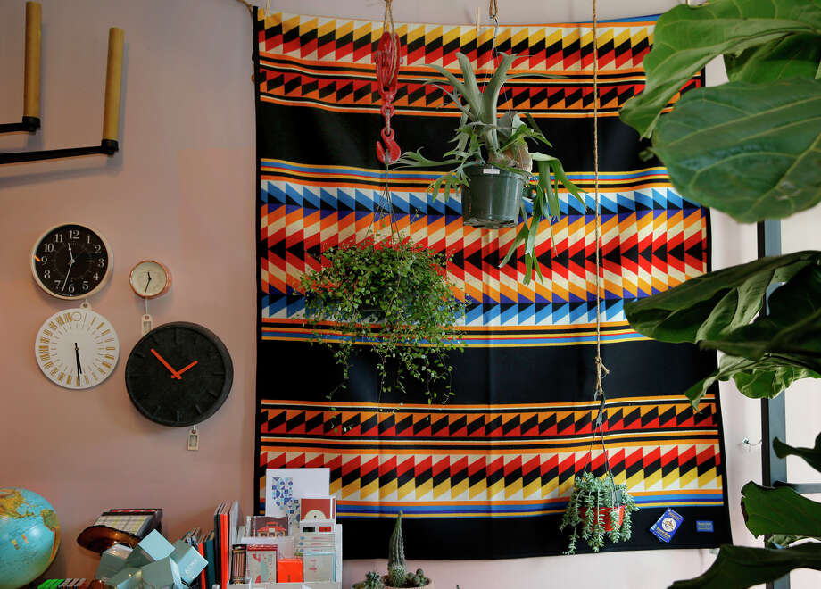 A colorful Pendleton blanket, houseplants and clocks near the front entrance of Aggregate Supply, which has everything from original designer clothes made locally to houseplants. Photo: Brant Ward / Brant Ward / The Chronicle / ONLINE_YES