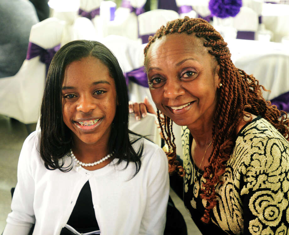 Madison Beckett, 12, and Rhoda Poe attend the Save Our Children banquet on Thursday night. A fundraiser and award banquet for the Save Our Children program was held at the Event Centre on Thursday night. Organizer Reverend J.D. Roberts said the event would pull between 250 and 300 people. Roberts said the Save Our Children program focuses on childhood literacy. Photo taken Thursday 2/19/15 Jake Daniels/The Enterprise Photo: Jake Daniels / ©2014 The Beaumont Enterprise/Jake Daniels