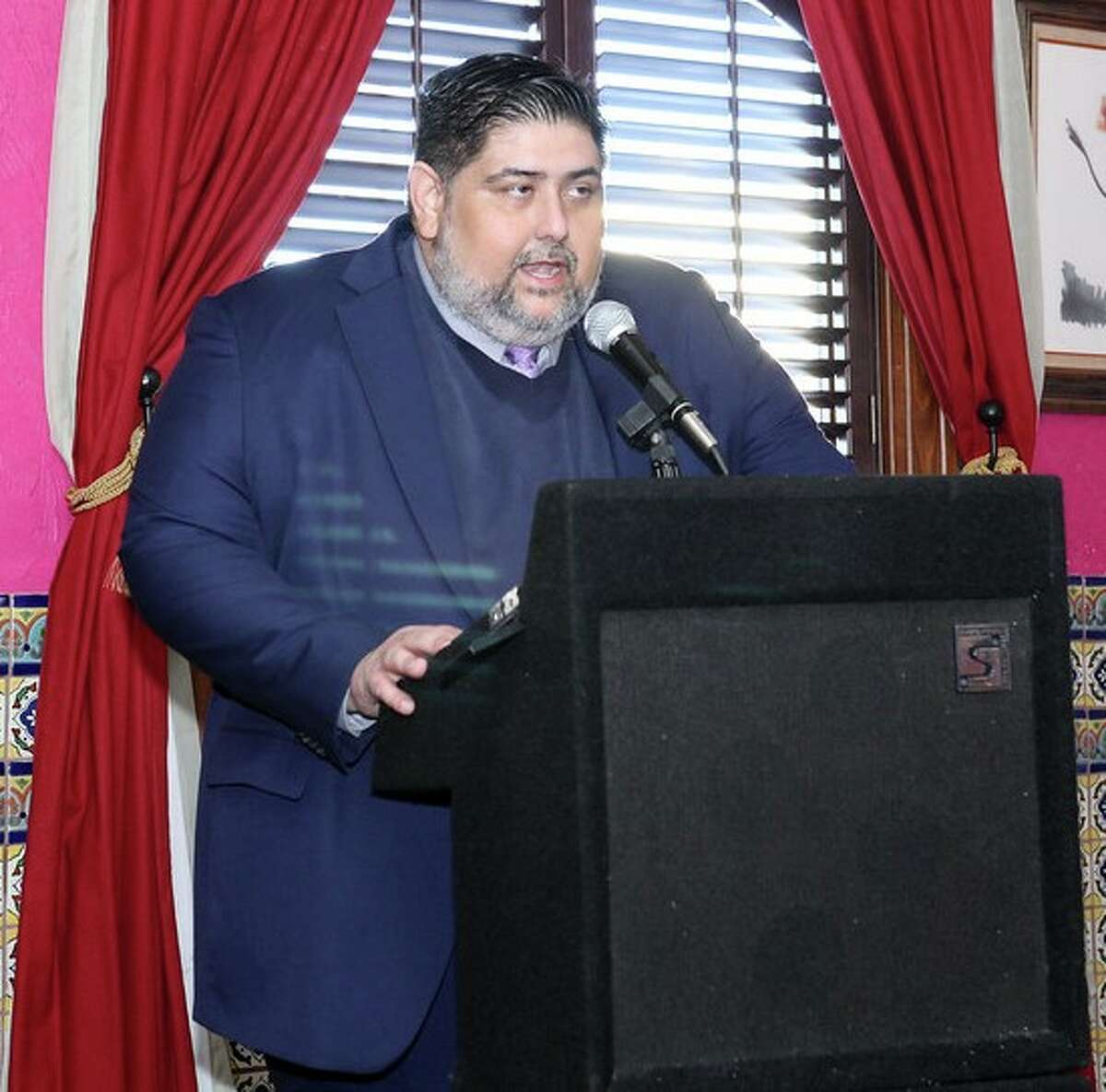 Gabe D. Farias, president and CEO of the West San Antonio Chamber of Commerce, addresses the audience at the chamber's annual State of the Chamber event on Jan. 28, 2015, at Pico de Gallo Mexican Restaurant.