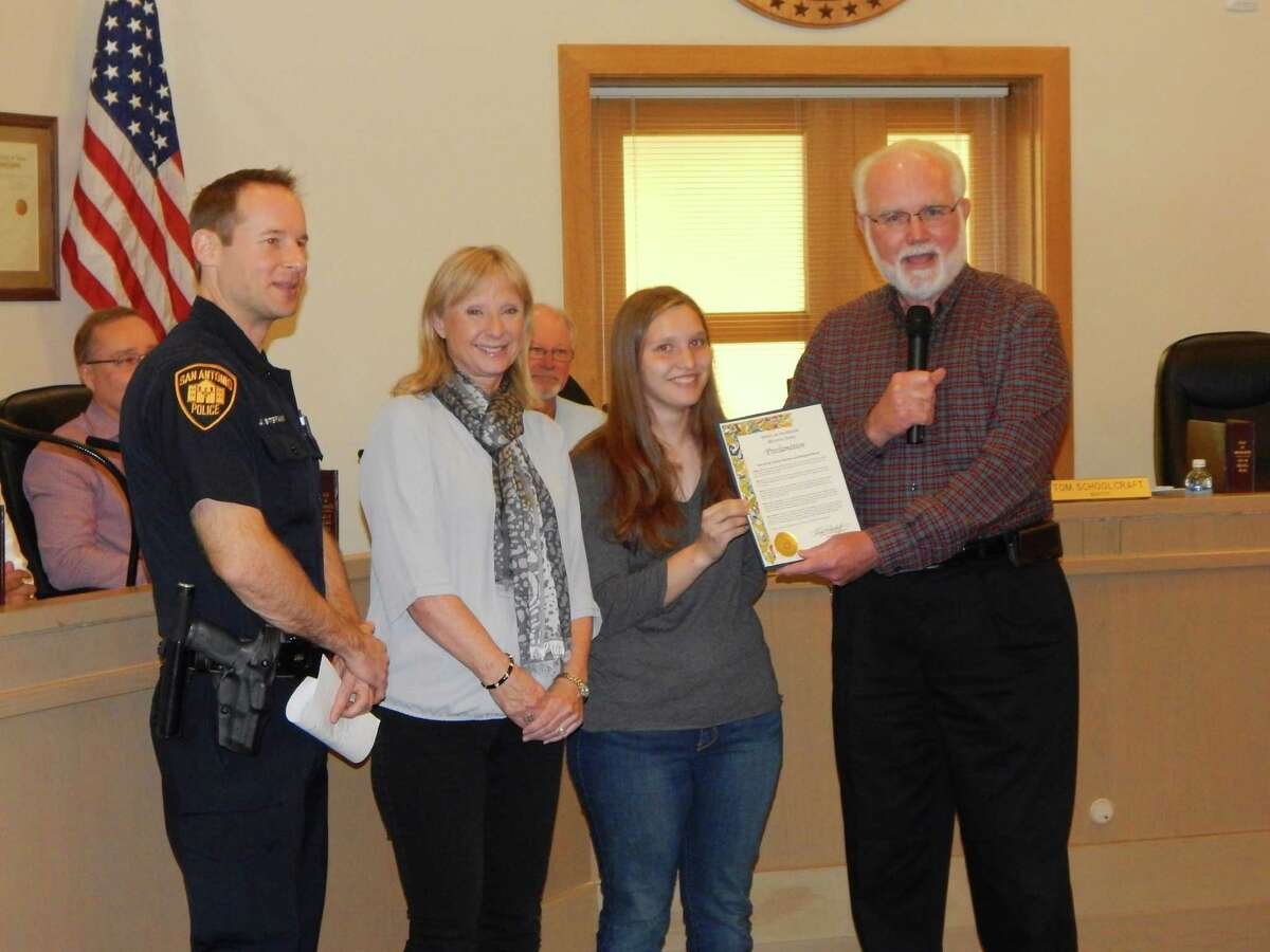 Michaela Willms, O'Connor High School PTSA student representative, third from left, accepts the proclamation declaring February Teen Dating Violence Awareness and Prevention Month from Helotes Mayor Tom Schoolcraft, far right. At left is San Antonio Police Officer Justin Stepanik and Dawn Koester, also representing the O'Connor PTSA.