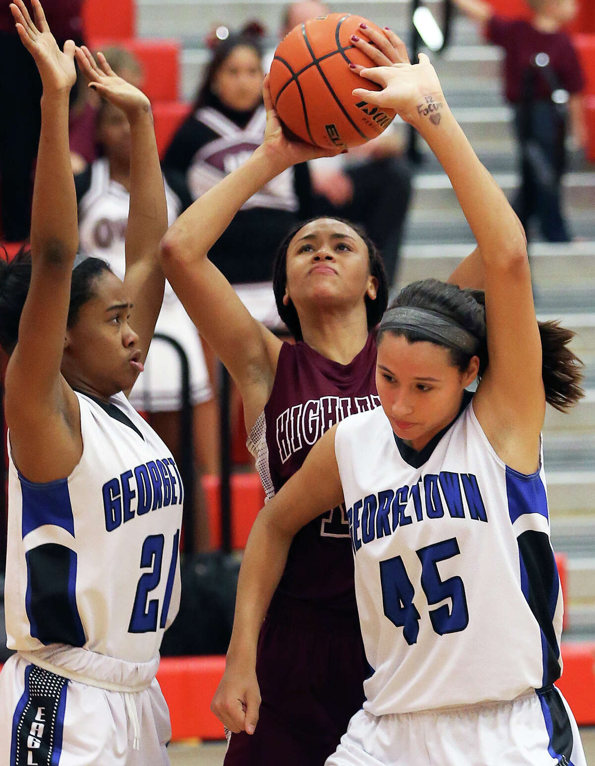 Owls forward Jazmine Jackson takes a shot over two George- town players in a 5A second- round playoff game Feb. 19.