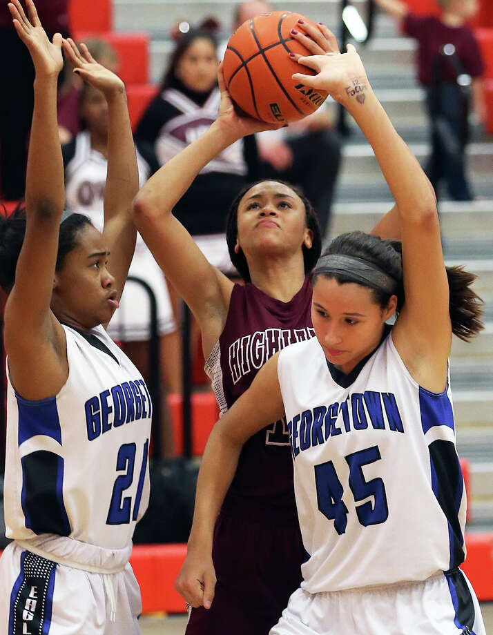Owls forward Jazmine Jackson takes a shot over two George- town players in a 5A second- round playoff game Feb. 19. Photo: Tom Reel /San Antonio Express-News