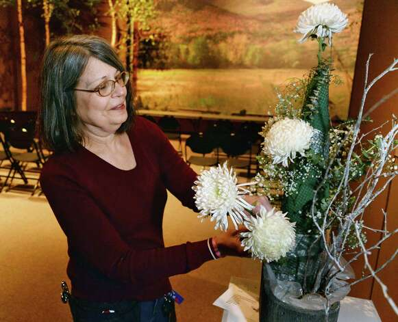 Diane Madden of North Greenbush her floral arrangement Thursday Feb. 19, 2015, at the NYS Museum for the annual New York in Bloom show in Albany, NY.  (John Carl D'Annibale / Times Union) Photo: John Carl D'Annibale / 00030443A