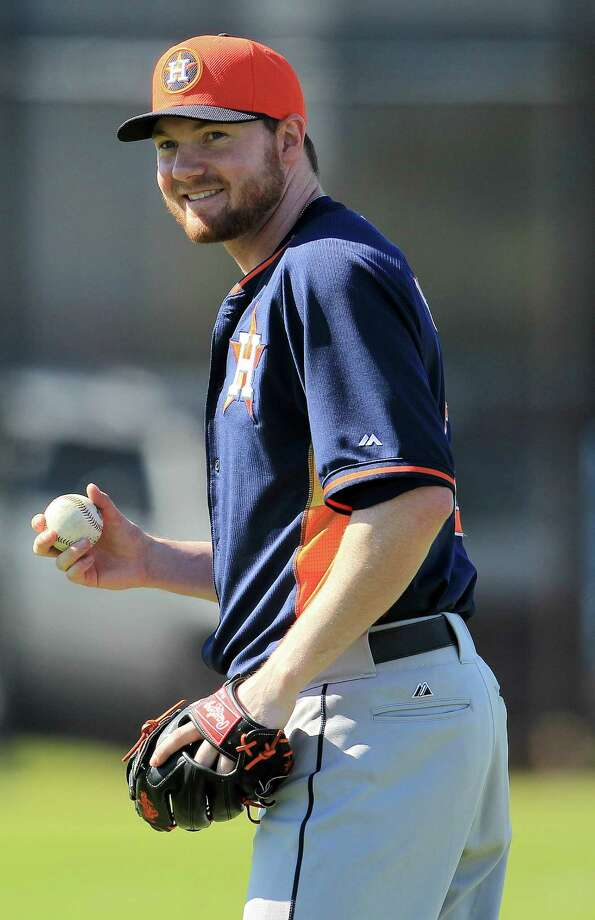 Houston Astros RHP Alex White (43) throws the ball during workouts for pitchers and catchers at the Houston Astros spring training facility, after having had Tommy John surgery last April, causing him to miss nearly the entire season, Monday, Feb. 17, 2014. ( Karen Warren / Houston Chronicle ) Photo: Karen Warren, Staff / © 2013 Houston Chronicle