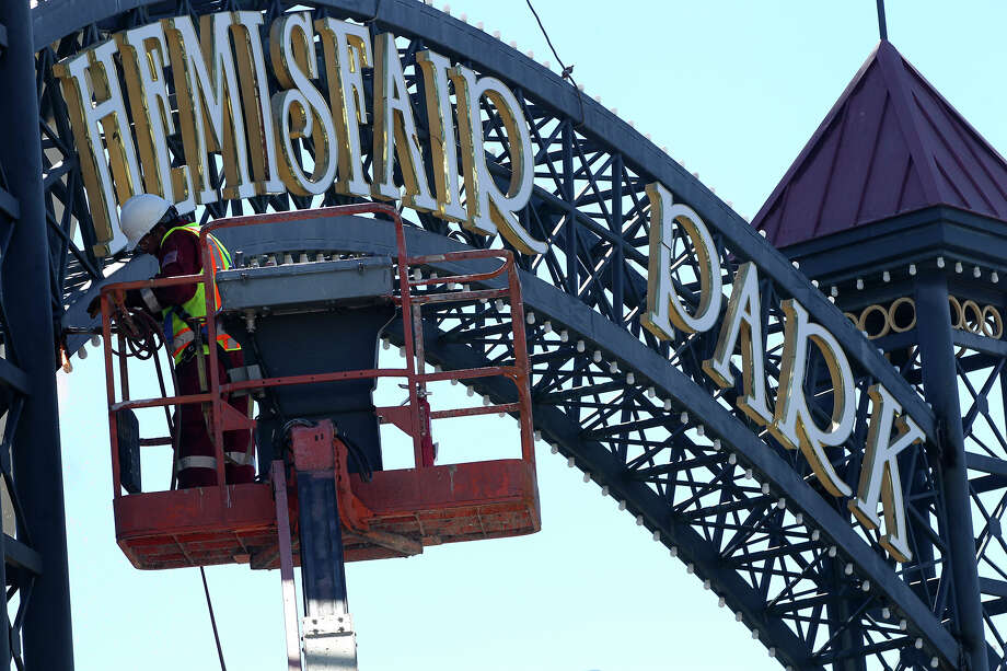 The sign for HemisFair Park in downtown San Antonio was dismantled this week, but it will be placed in storage while its fate is discussed. Photo: JOHN DAVENPORT, STAFF / ©San Antonio Express-News/John Davenport