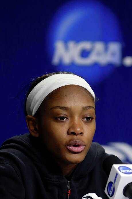 Texas A&M's Courtney Walker speaks during a news conference, Sunday, March 30, 2014, ahead of a regional finals game in the NCAA women's college basketball tournament in Lincoln, Neb. Texas A&M will play Connecticut in the finals on Monday. (AP Photo/Nati Harnik) Photo: Nati Harnik, STF / AP