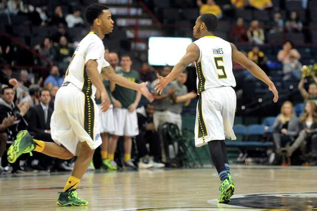Siena's Marquis Wright, left, and Evan Hymes celebrate a combined effort during their basketball game against Canisius on Thursday, Feb. 19, 2015, at Times Union Center in Albany, N.Y. (Cindy Schultz / Times Union) Photo: Cindy Schultz / 00030520B