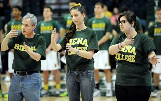 Siena College's Sign Language Club translates the National Anthem at the start of their team's basketball game against Canisius on Thursday, Feb. 19, 2015, at Times Union Center in Albany, N.Y. (Cindy Schultz / Times Union) Photo: Cindy Schultz / 00030520B