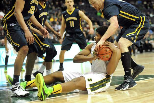 Siena's Lavon Long center, holds onto a loose ball during their basketball game against Canisius on Thursday, Feb. 19, 2015, at Times Union Center in Albany, N.Y. (Cindy Schultz / Times Union) Photo: Cindy Schultz / 00030520B