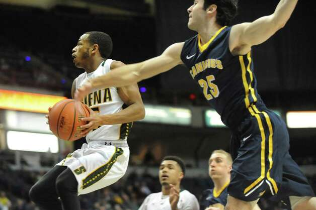 Siena's Evan Hymes, left, goes to the hoop as Canisius' Adam Weir defends during their basketball game on Thursday, Feb. 19, 2015, at Times Union Center in Albany, N.Y. (Cindy Schultz / Times Union) Photo: Cindy Schultz / 00030520B