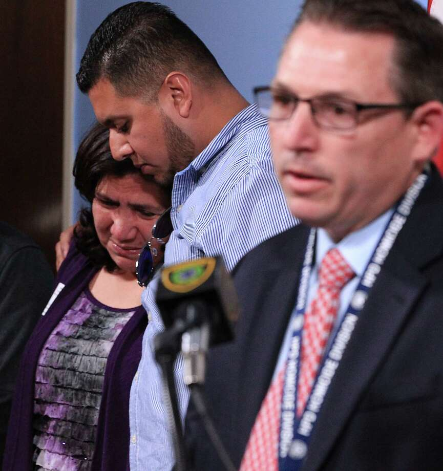 Libier Medrano left, is comforted by her son Erick Gutierrez center, as Houston Police Department Homicide Detective Warren Meeler right, speaks about the death of Medrano's son Frank Medrano, 19 who was shot and killed in an apparent robbery at a construction site Wednesday, during a press conference at the Houston Police Department headquarters Thursday, Feb. 19, 2015, in Houston. Photo: James Nielsen, Houston Chronicle / © 2015  Houston Chronicle