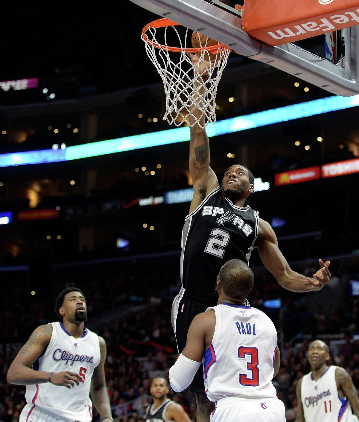 LOS ANGELES, CA - FEBRUARY 19: Kawhi Leonard #2 of the San Antonio Spurs misses a layup in front of Chris Paul #3 and DeAndre Jordan #6 during a 119-115 Clipper win at Staples Center on February 19, 2015 in Los Angeles, California. NOTE TO USER: User expressly acknowledges and agrees that, by downloading and or using this Photograph, user is consenting to the terms and condition of the Getty Images License Agreement. (Photo by Harry How/Getty Images)