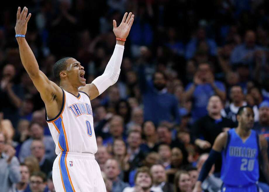 Oklahoma City Thunder guard Russell Westbrook (0) gestures to the crowd following a dunk in the first quarter of Oklahoma City's victory over the Mavericks on Thursday night. Westbrook finished with 34 points. Photo: Sue Ogrocki / Associated Press / AP