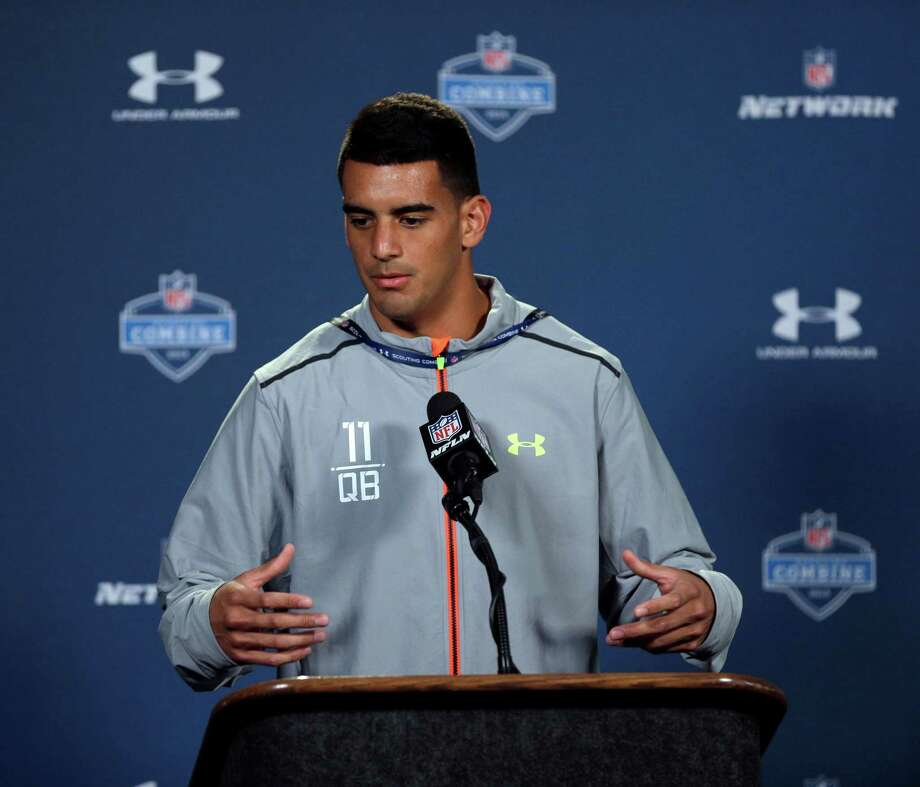 University of Oregon quarterback Marcus Mariota answers a question during a news conference at the NFL scouting combine in Indianapolis on Thursday. Photo: David J. Phillip / Associated Press / AP