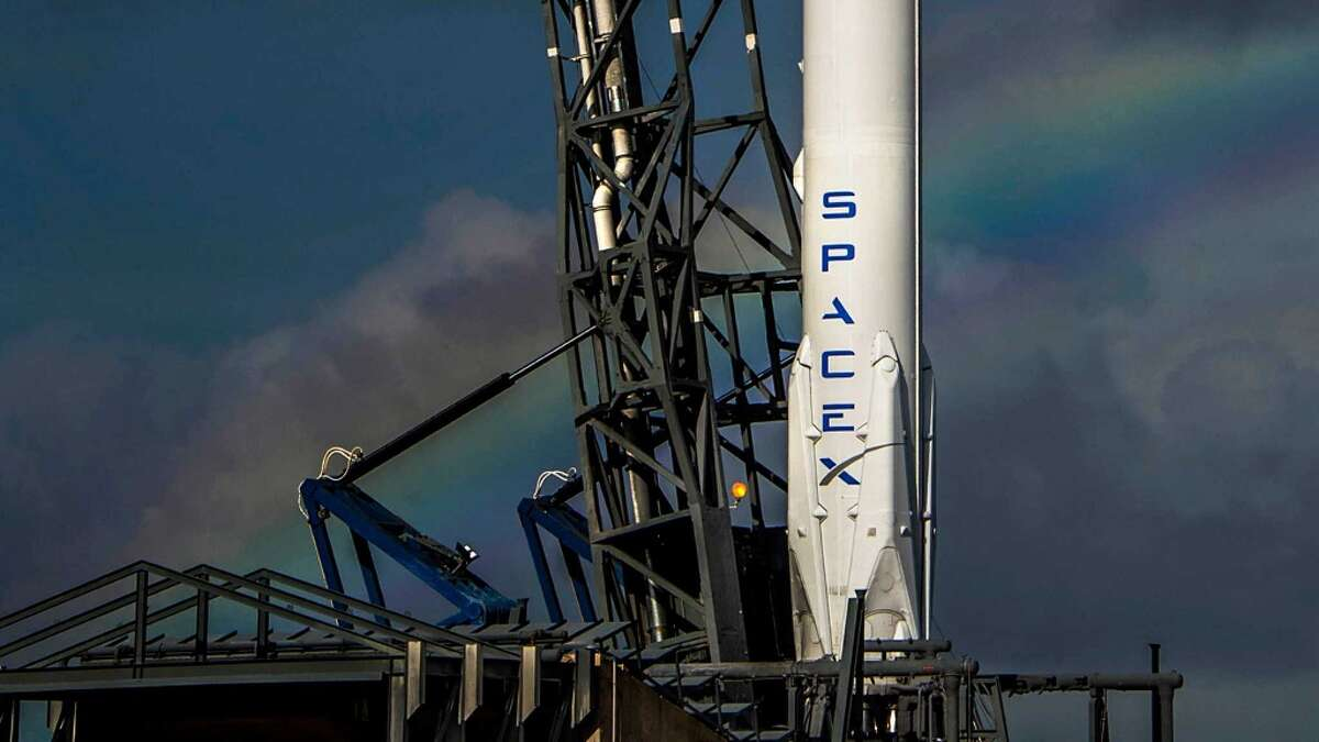 SpaceX Purpose: Develop reusable rockets that can take astronauts and materials to the International Space Station. Eventually, Elon Musk's company wants to take people to Mars. A rainbow is seen behind Launch Complex 40 at the Cape Canaveral Air Force Station as a SpaceX Falcon 9 rocket and its Dragon cargo craft are prepared for launch.