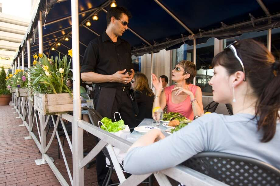 1. Boston: Median Hourly tips - $13 (with $6.00 average base pay) Photo: Lou Jones, Getty Images/Lonely Planet Images