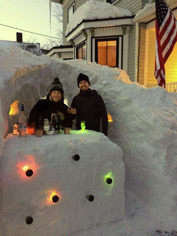 "Texas couple Kristy Nardone and Chris Haynes celebrate the ""opening"" of their snow bar in Boston. Photo: David Pitzold Jr."