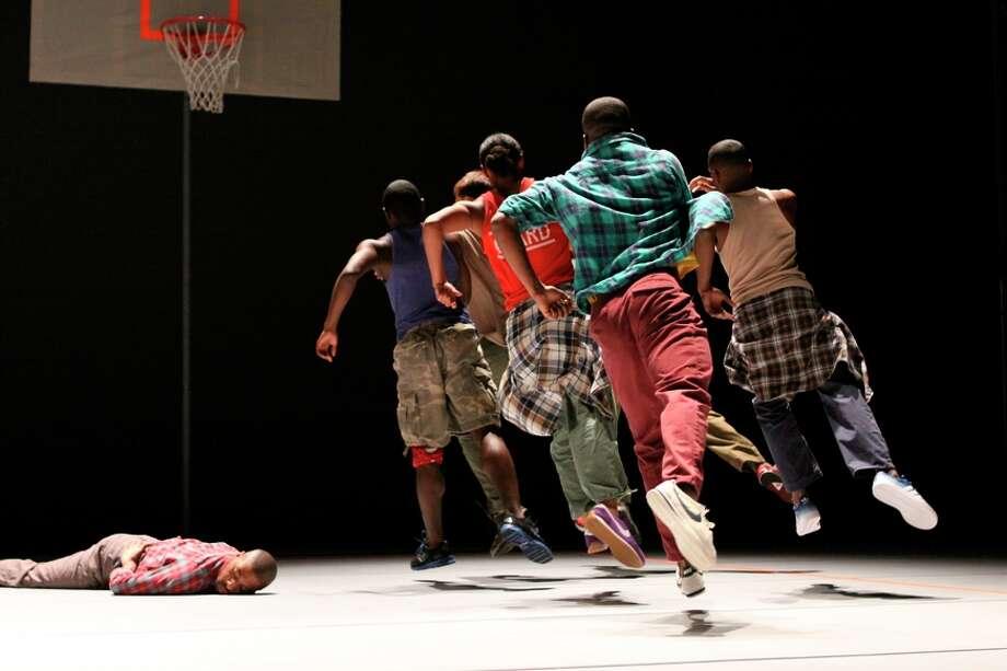 """Dancer-choreographer Kyle Abraham (on floor) and his Kyle Abraham / Abraham.In.Motion perform """"Pavement."""" Photo: Steven Schreiber / Steven Schreiber / ONLINE_YES"""