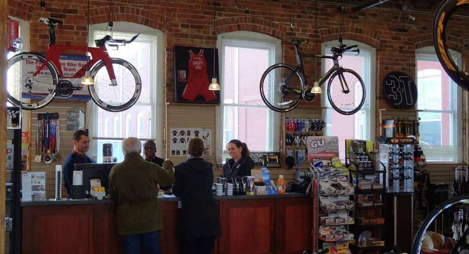 Pacific Swim Bike Run is entering it's fourth season of business in Stamford's South End, owned by triathlete Julie Gabay and her husband Yori. Julie Gabay, right, and her staff are pictured helping customers on Friday, February 20, 2015. Photo: Alexander Soule / Stamford Advocate