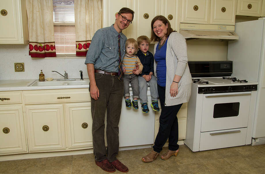 Joshua and Emily Robbins with their children Caedmon, 15 months, and Harper, 3, are purchasing a home in Monticello Park. The Robbinses received a $15,000 grant for down-payment assistance from the NeighborhoodLIFT program. Photo: Alma E. Hernandez /For The Express-News