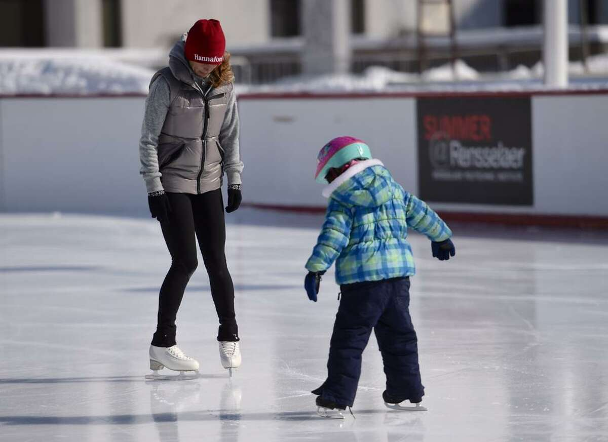 Olympic gold medalist Ekaterina Gordeeva skates with a young fan on Friday at the Empire State Plaza Ice Rink. Gordeeva started staking at about 11 a.m. and was expected to remain at the rink until 1 p.m. (Skip Dickstein / Times Union)