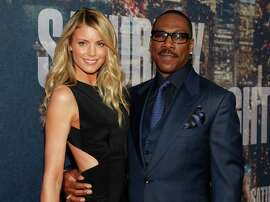 """Paige Butcher (left) and Eddie Murphy attend the """"SNL 40th Anniversary Special in New York."""