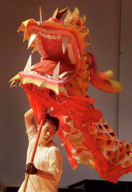The Dragon Dance during the Lunar New Year Festival at the Chinese Community Center. Photo: Melissa Phillip, Houston Chronicle / © 2014  Houston Chronicle