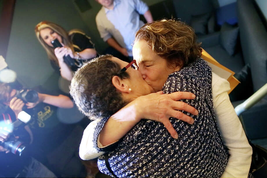 Sarah Goodfriend and Suzanne Bryant kiss at a reception in Austin following their marriage earlier that morning Thursday Feb. 19, 2015. Goodfriend and Bryant are the first legally wed gay couple in Texas. (AP Photo/The Daily Texan, Shelby Tauber) Photo: Shelby Tauber, Associated Press / The Daily Texan