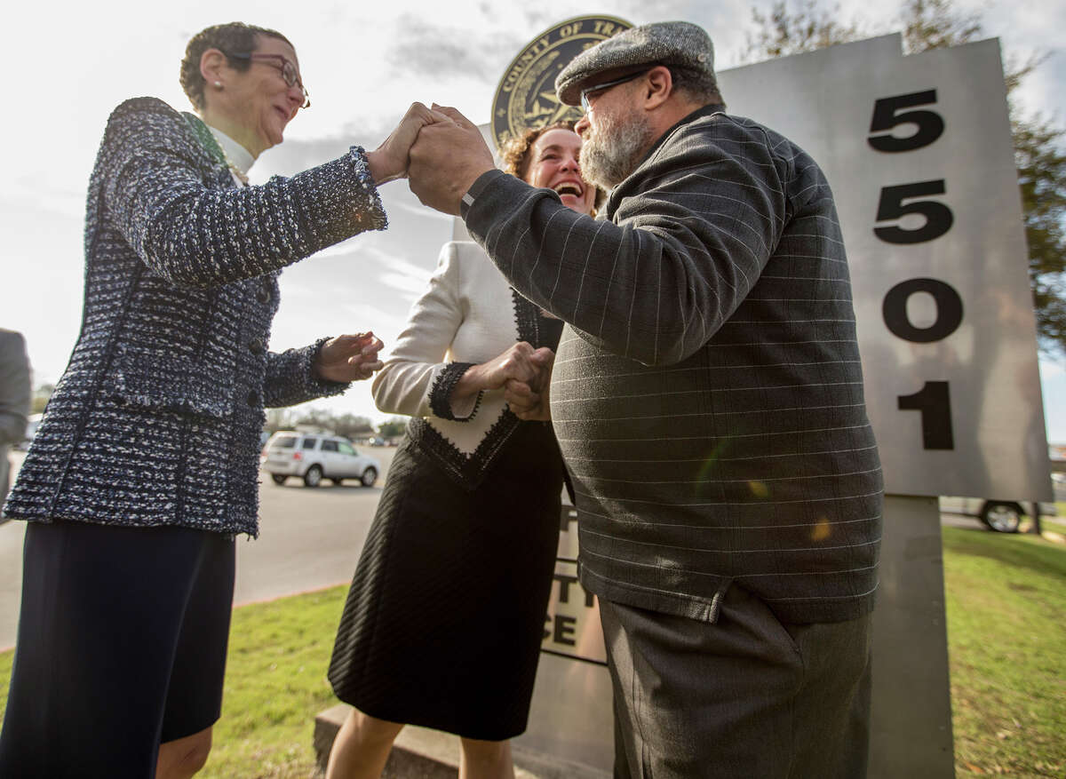 Sarah Goodfriend, left, and Suzanne Bryant hold hands with Rabbi Kerry Baker during their wedding ceremony outside of the Travis County Clerk's office in Austin, Texas on Thursday morning, Feb. 19, 2015. Travis County spokeswoman Ginny Ballard said the marriage occurred Thursday, though it wasn't immediately clear if the license has legal standing. The marriage followed a state District Court order instructing that officials not rely on Texas' unconstitutional prohibitions on same-sex marriage. (AP Photo/Austin American-Statesman, Ricardo B. Brazziell)
