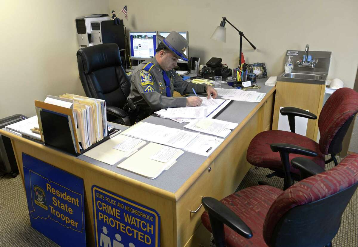 Michael Saraceno, resident state trooper in Sherman, works in his office in the Emergency Services building in Sherman, Conn, on Friday, February 20, 2015.