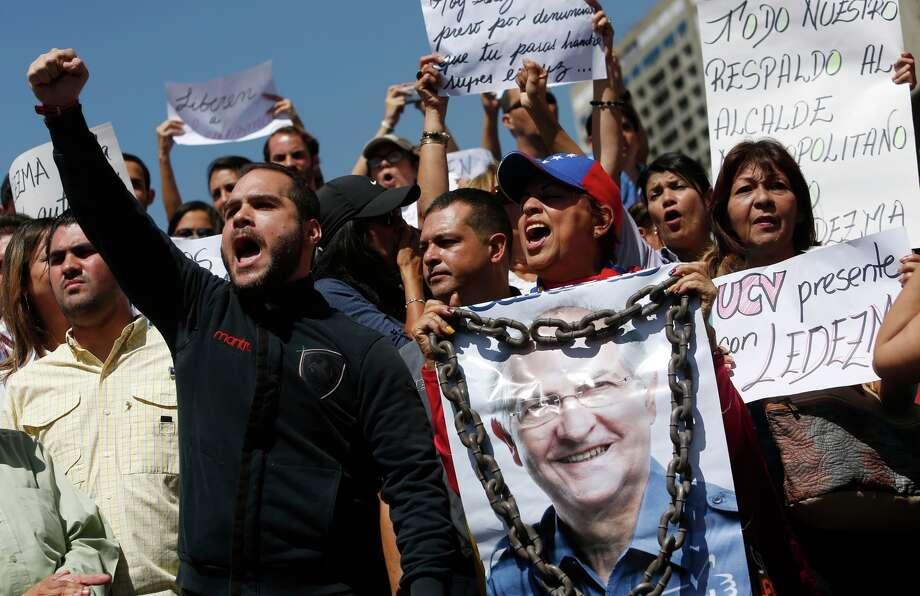 Supporters of Mayor Antonio Ledezma take to the streets of of Caracas, Venezuela, to protest his arrest. Photo: Alejandro Cegarra / Associated Press / AP