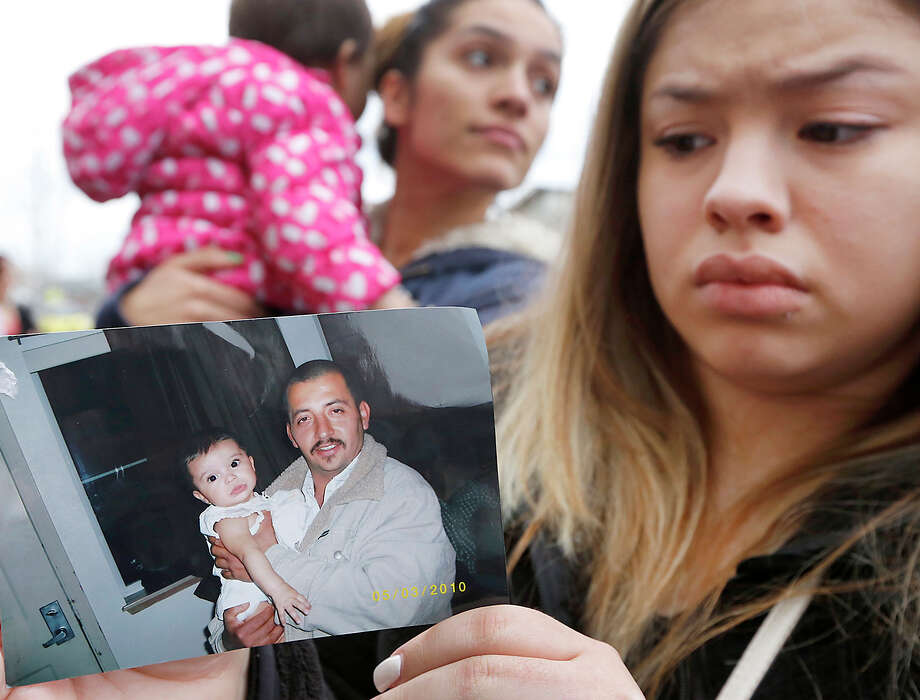 Erika Zambrano holds a photo of Antonio Zambrano-Montes, who was fatally shot by police officers. Photo: Bob Brawdy / McClatchy-Tribune News Service / Tri-City Herald