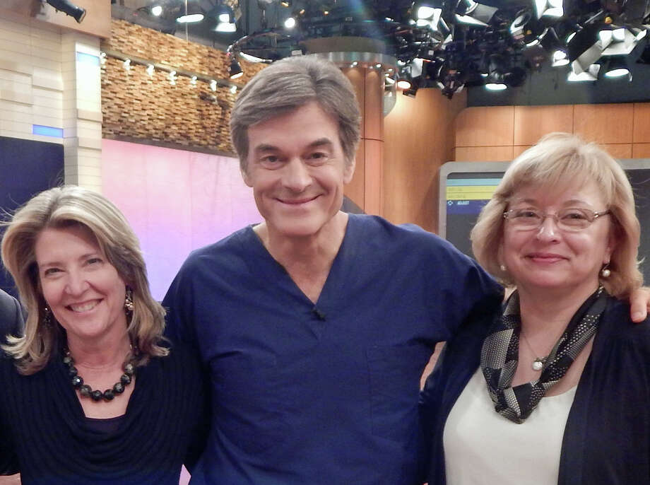 Cindi Bigelow, president and CEO of Bigelow Tea in Fairfield, (L), and Elaine Gavoli, Bigelow communications manager, (R), with Dr. Mehmet Oz.  The two local women were at a recent taping of Oz's TV show. Photo: Contributed Photo / Greenwich Time Contributed