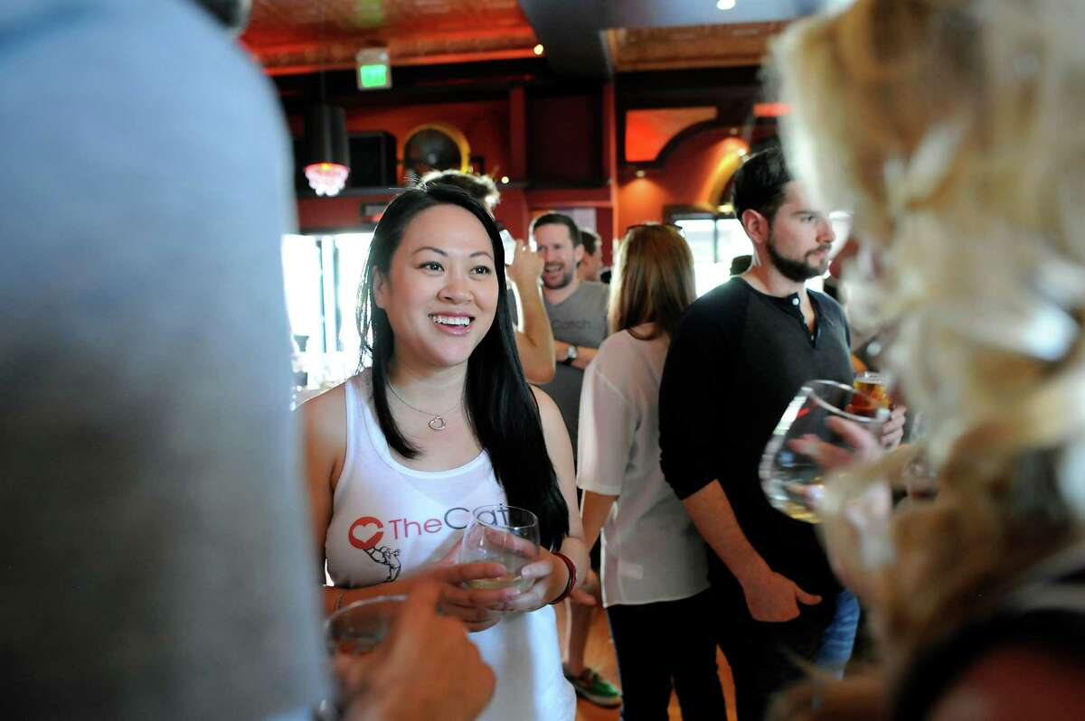 The Catch founder and CEO Shannon Ong chats with guests during a Valentine's Day singles event at Mayes Oyster House in San Francisco.
