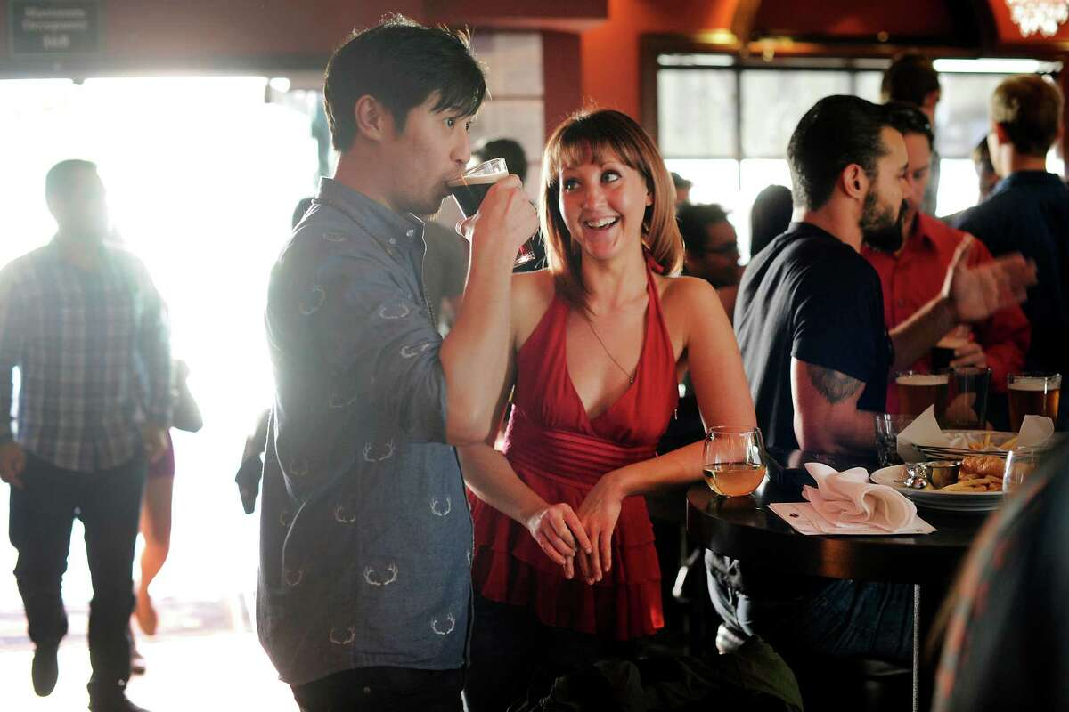 Alex Wu and Molly Shelestak chat over drinks during a Valentine's Day singles event celebrating the launch of the new dating app the Catch at Mayes Oyster House in San Francisco.