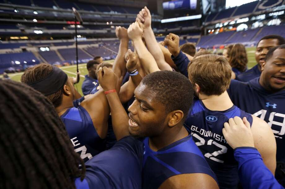 Duke offensive lineman Laken Tomlinson, foreground center, huddles with athletes after participating in the NFL football scouting combine in Indianapolis, Friday, Feb. 20, 2015. (AP Photo/Julio Cortez) Photo: Associated Press