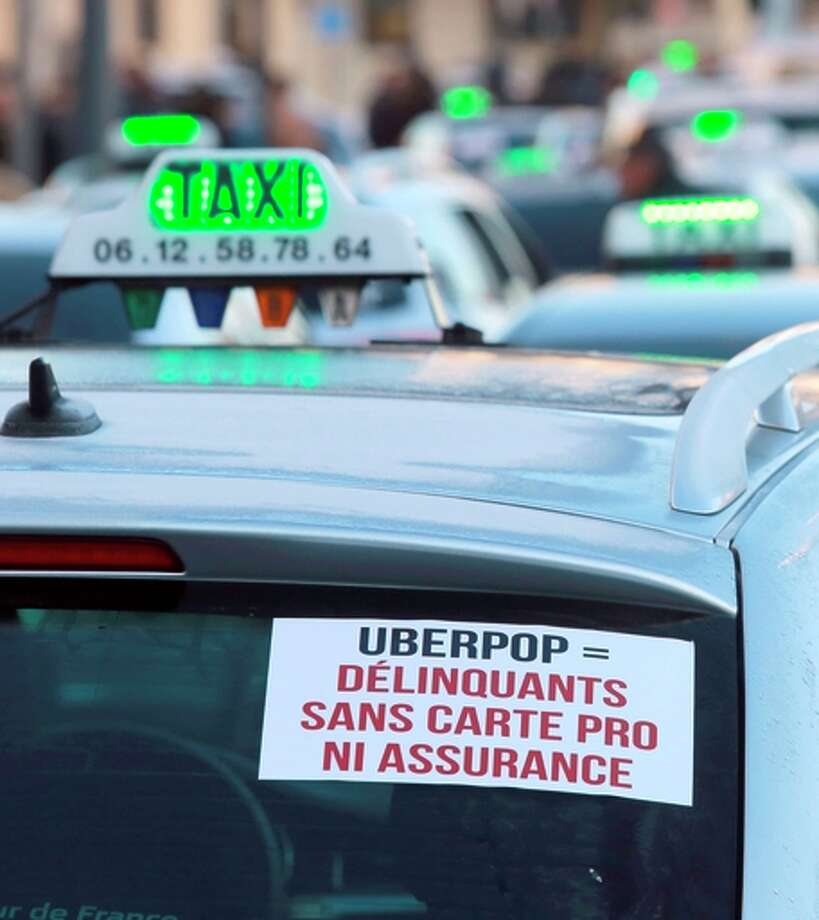 Some 400 taxi drivers block the area of Bordeaux's train station in an Uber protest. Photo: NICOLAS TUCAT / AFP / Getty Images / AFP