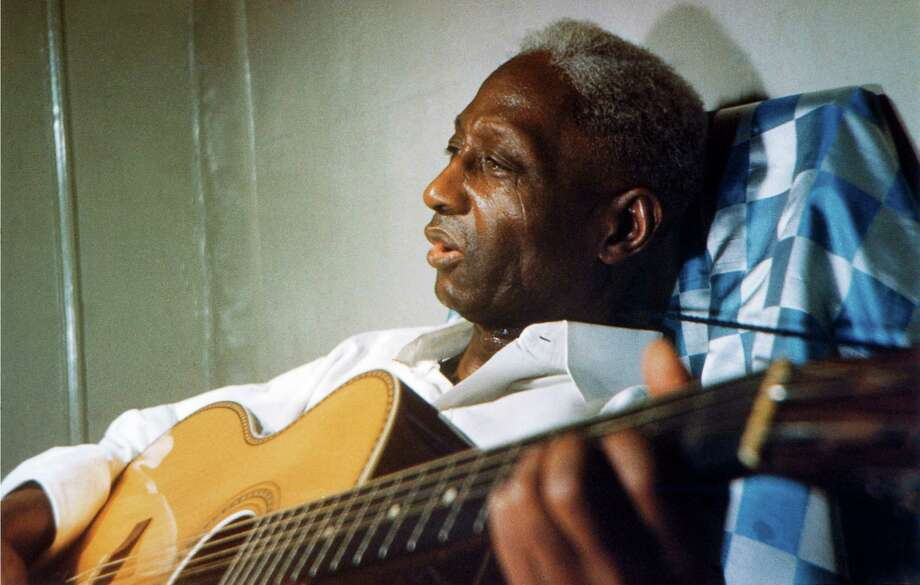 Folk singer Lead Belly in New York, in his final days. His music inspired the Beatles and other famous musicians. Photo: RICHARD S BLACHER/LEAD BELLY EST / Richard Blacher / Lead Belly Estate / SMITHSONIAN FOLKWAYS