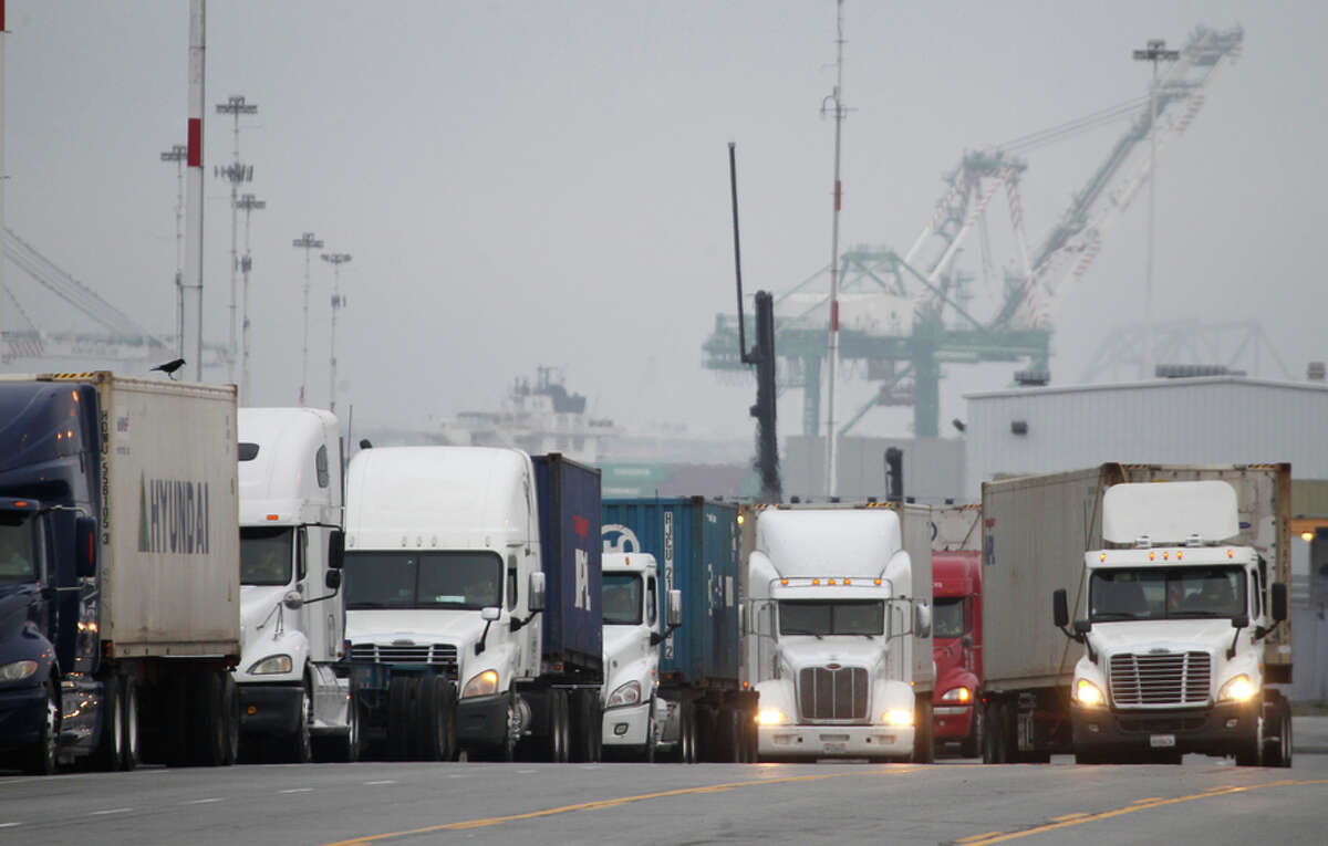 Trucks line up to enter the Port of Oakland, which was caught in the middle of the conflict, Feb. 20, 2015.