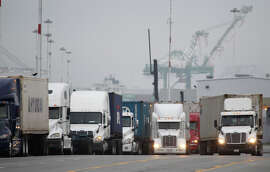 "Trucks line up to enter the Port of Oakland, which was caught in the middle of the conflict , Feb. 20, 2015 . ""It's time for all sides to pull together and get cargo moving,"" the port's executive director says. The port resumed operations one day after a shutdown because of an all-day meeting by union workers Thursday. Both sides in the labor dispute returned to the negotiation table Friday."