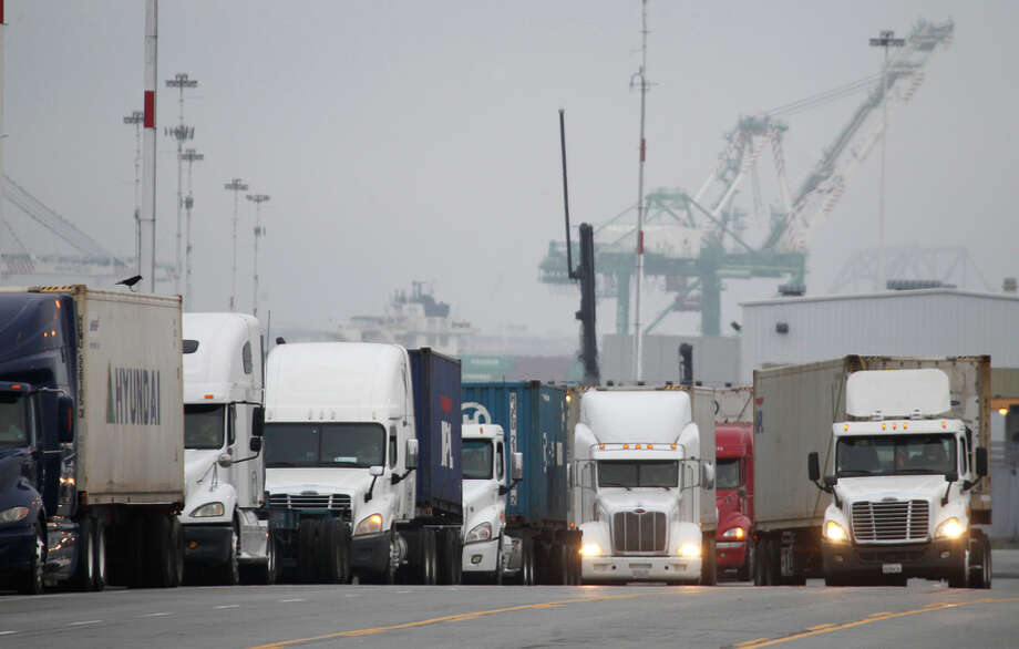 "Trucks line up to enter the Port of Oakland, which was caught in the middle of the conflict, Feb. 20, 2015. ""It's time for all sides to pull together and get cargo moving,"" the port's executive director says.The port resumed operations one day after a shutdown because of an all-day meeting by union workers Thursday. Both sides in the labor dispute returned to the negotiation table Friday. Photo: Paul Chinn / The Chronicle / ONLINE_YES"