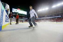 Television producer Scott Moring tests the ice at Levi's Stadium during a media session leading up to Saturday's game.