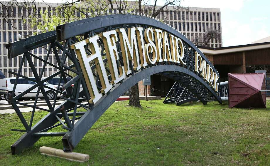 The Hemisfair Park arch is resting next to the old Womans Pavilion Building close to the Federal Courthouse.  Hemisfair planners say the beloved arch will be re-erected at a new location in the park.  Friday, Feb. 20, 2015. Photo: Bob Owen, San Antonio Express-News / © 2015 San Antonio Express-News
