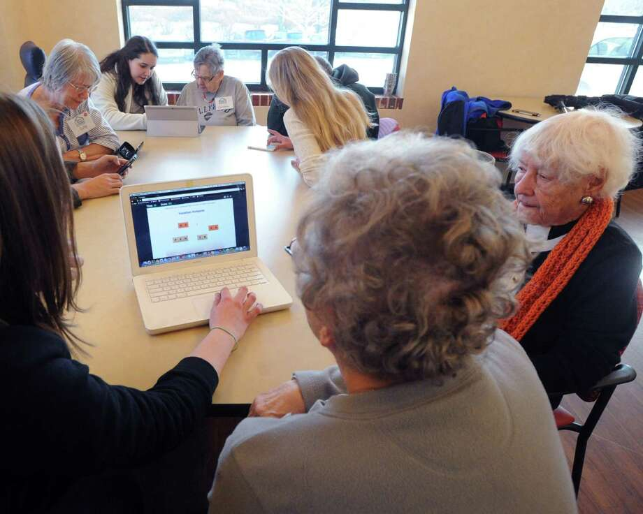Greenwich High School seniors teach a digital technology workshop at the River House Adult Day Center in the Cos Cob section of Greenwich, Conn., Feb. 20, 2015. Photo: Bob Luckey / Greenwich Time