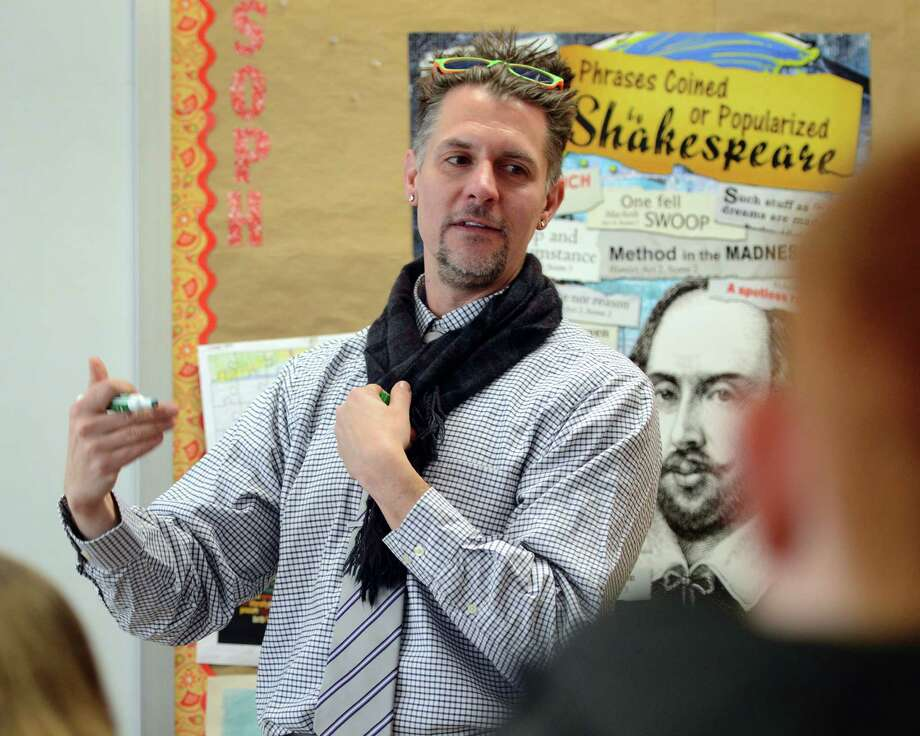 Bryan Crandall, director of the Connecticut Writing Project, works with a group of seniors at Joel Barlow High School in Redding, Conn., Friday, Feb. 20, 2015. His program could be cut if the Governor's proposed budget is passed. Photo: Autumn Driscoll / Connecticut Post