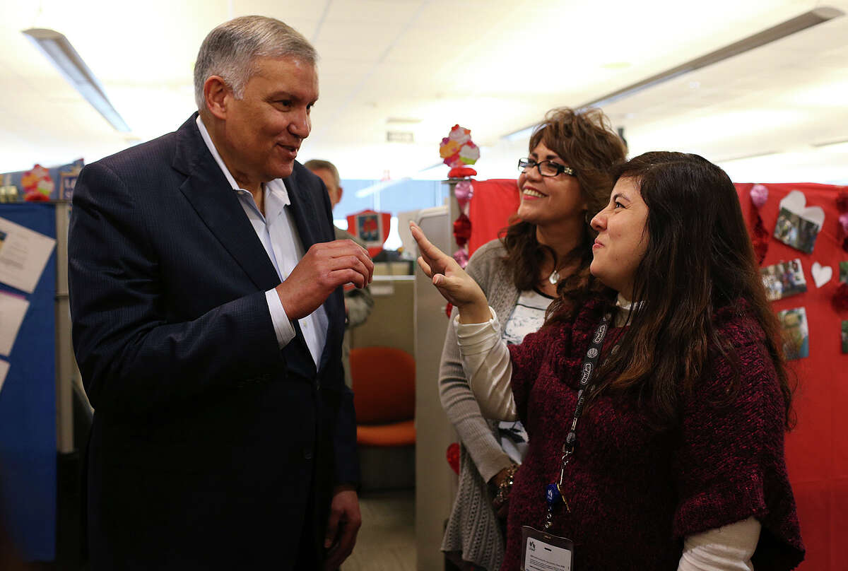 USAA President and CEO Joe Robles, left, talks with Sylvia Webber, center, and Veronica G. Rodriguez, during a visit with employees of the USAA Bank Consumer Loan Department, Wednesday, February 18, 2015. Robles assumed the position in 2007 and will retire at the end of the month. Robles retired as a major general in the U.S. Army in 1994 and soon after joined USAA.